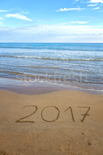 Drawing 2017 on the sand Stock photo © digoarpi