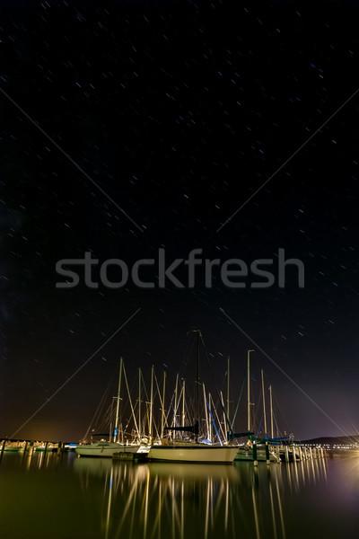 Sailboats in the harbor on the lake Stock photo © digoarpi
