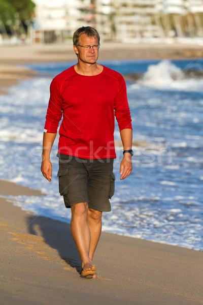 Moço jovem homem feliz mar Foto stock © digoarpi