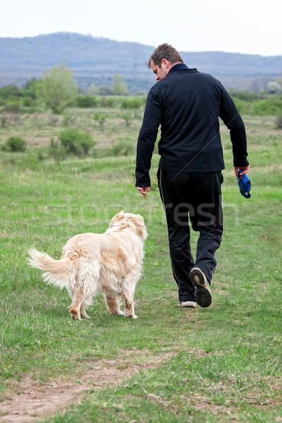 человека собака молодым человеком ходьбе спорт фитнес Сток-фото © digoarpi