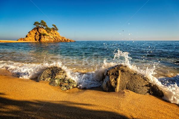 Bom pormenor espanhol costa água pôr do sol Foto stock © digoarpi