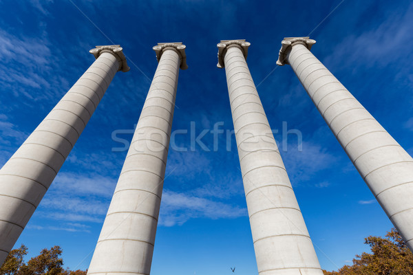 Four massive columns, blue sky in Barcelona of Spain Stock photo © digoarpi