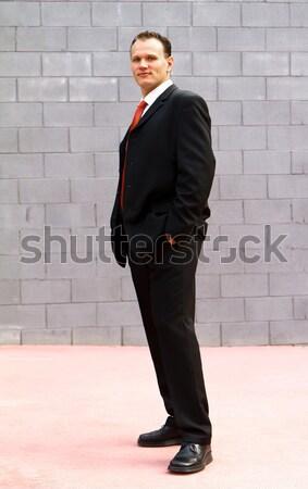 Empresário jovem chamada telefone móvel laranja Foto stock © digoarpi
