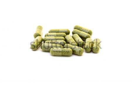 Vert chlorophylle capsules blanche alimentaire herbe Photo stock © digoarpi