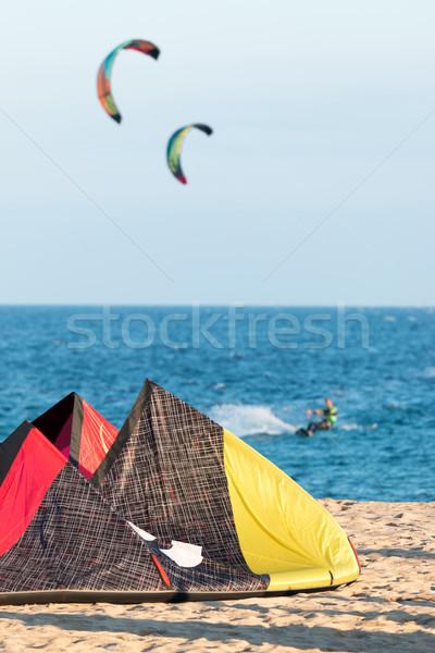 Cometa arena agua hombre mar azul Foto stock © digoarpi