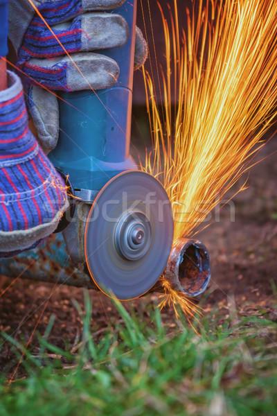 Cutting steel with grinder machine close up Stock photo © digoarpi