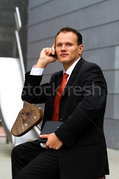 Empresário jovem falante celular sorrir trabalhar Foto stock © digoarpi