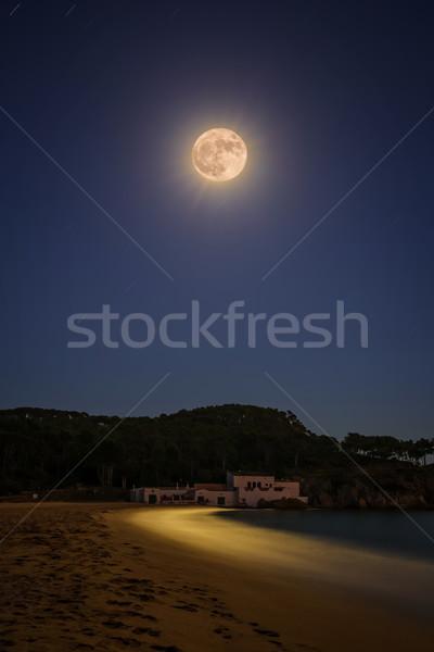 Full moon over the Spanish beach, near the small holiday village Stock photo © digoarpi