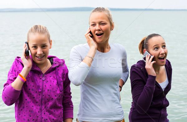 女の子 3  幸せ 携帯 電話 ストックフォト © digoarpi