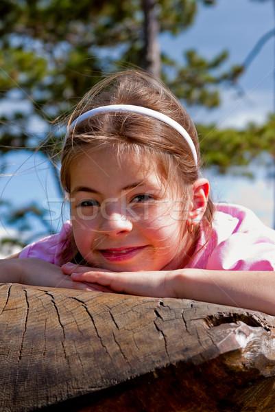 Lány gyönyörű kilenc éves pad tavasz arc Stock fotó © digoarpi