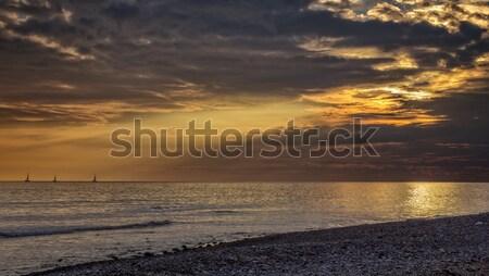 Grand puissant coucher du soleil nuages été océan Photo stock © digoarpi