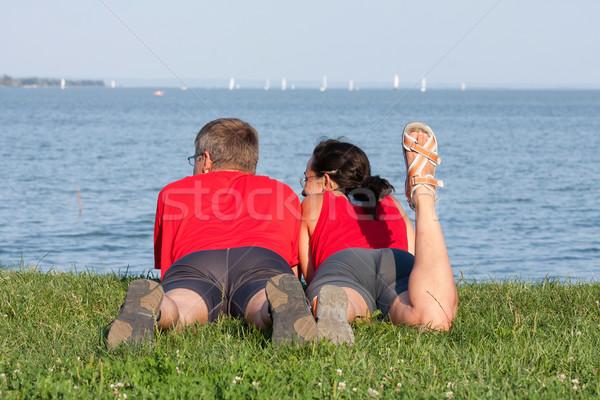 Casal alegre costa lago céu Foto stock © digoarpi