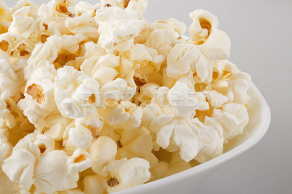 Popcorn blanche bol alimentaire nuit Photo stock © DimaP