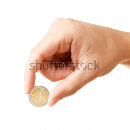 Hand holding 2 Euro coin Stock photo © Dinga