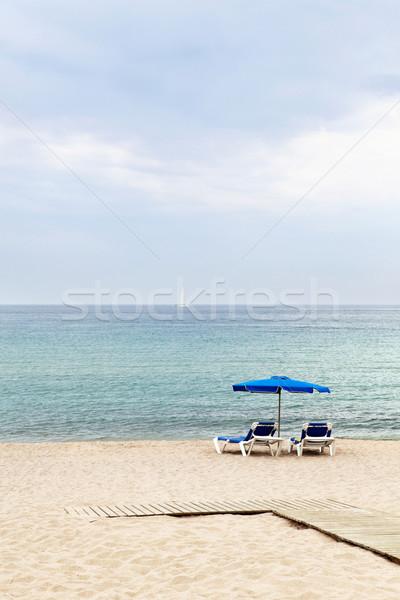два зонтик спокойный пляж морем Сток-фото © Dinga