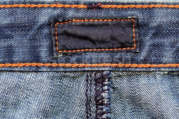 Foto stock: Escuro · etiqueta · jeans · cor · algodão