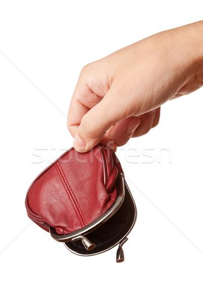 Hand holding empty money pouch Stock photo © Dinga
