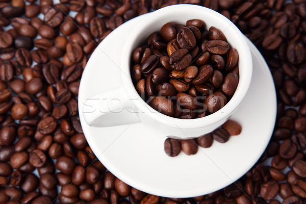 Cup full of coffee beans Stock photo © Dinga