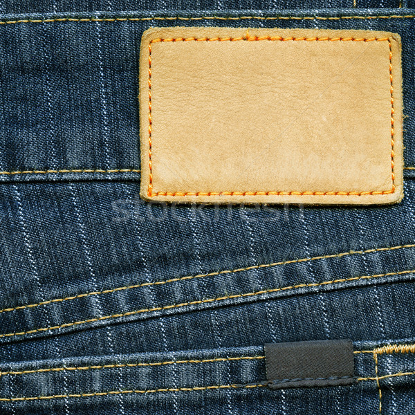 Blank leather label and small cotton label on striped blue denim Stock photo © Dinga