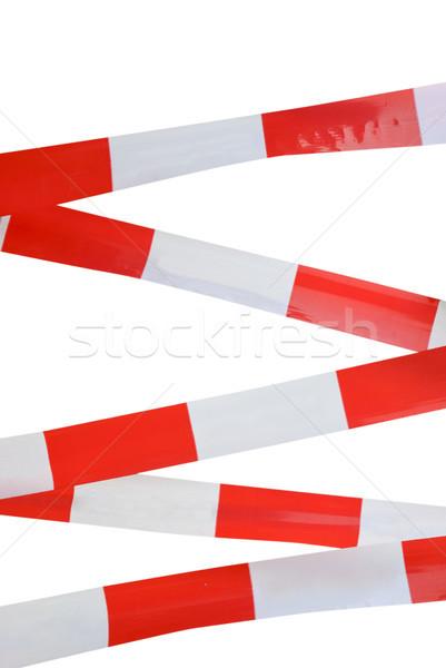 Red and white striped tape Stock photo © dinozzaver