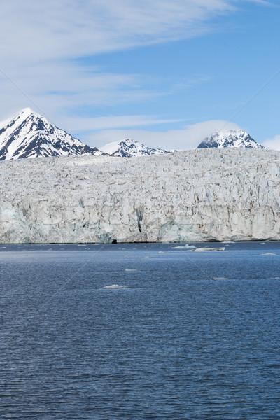 Gleccser sarkköri hegyek mögött természet tájkép Stock fotó © dinozzaver