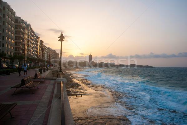 Promenade zonsondergang Malta strand hemel water Stockfoto © dinozzaver