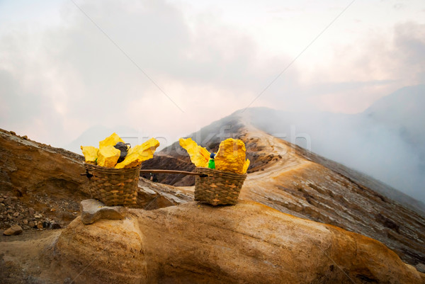 Baskets with sulphur at Kawah Ijen krater, Indonesia Stock photo © dinozzaver