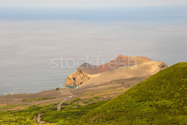 Vulcão luz casa ilha céu água Foto stock © dinozzaver