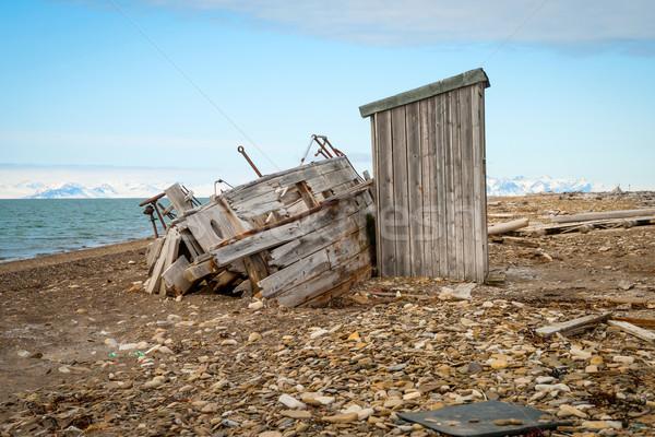 Abandoned ship on the shore in Svalbard Stock photo © dinozzaver