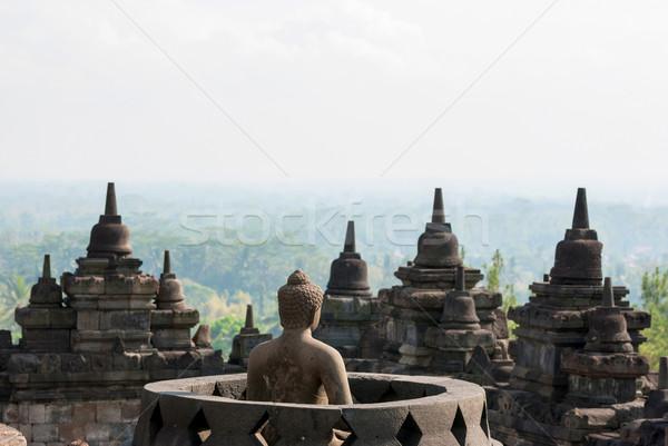Budist tapınak Endonezya Buda görmek gün batımı Stok fotoğraf © dinozzaver