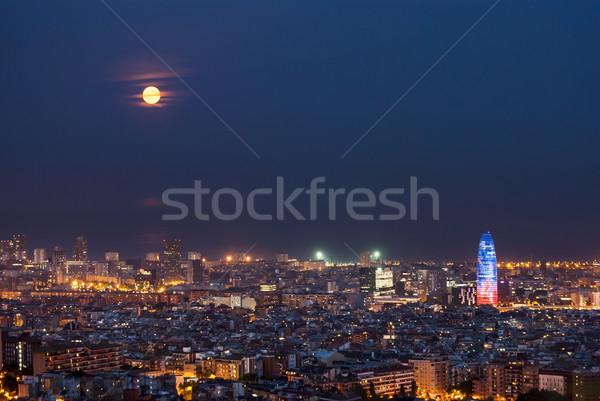 Barcelona at night with full moon, Spain Stock photo © dinozzaver