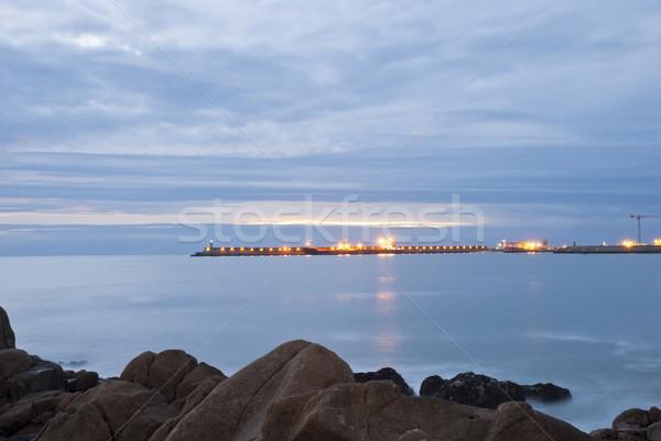 Long exposure of beach with pier Stock photo © dinozzaver