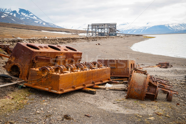 Old rusted minig equipment on shore, Svalbard Stock photo © dinozzaver