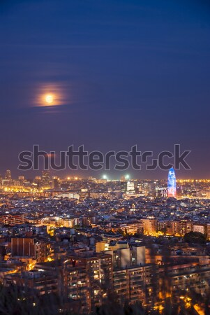 Barcelona at night with full moon, Spain Stock photo © dinozzaver