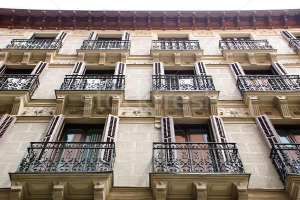House with balconies, Madrid Stock photo © dinozzaver
