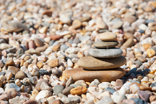Stack of pebble stones on the beach Stock photo © dinozzaver