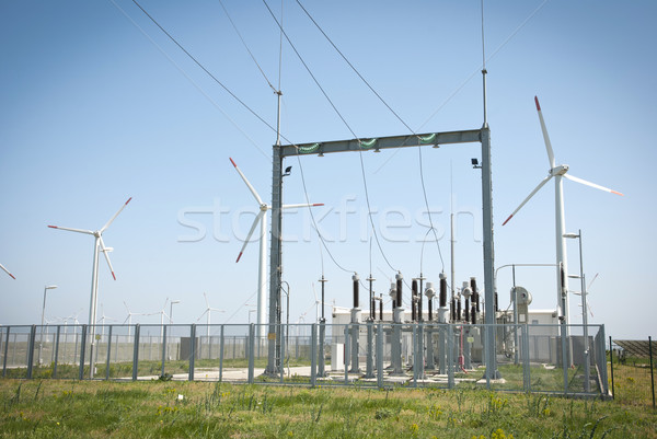 Power transformator between wind turbines Stock photo © dinozzaver