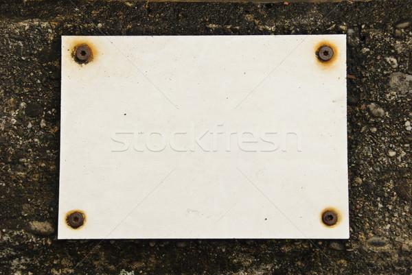 Vazio conselho parede papel construção luz Foto stock © dinozzaver