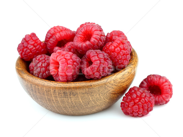 Raspberry on a wooden plate Stock photo © Dionisvera