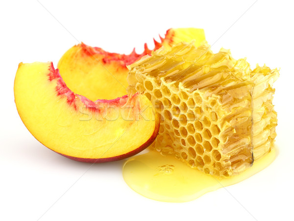 Sweet slices of nectarine with honeycombs Stock photo © Dionisvera