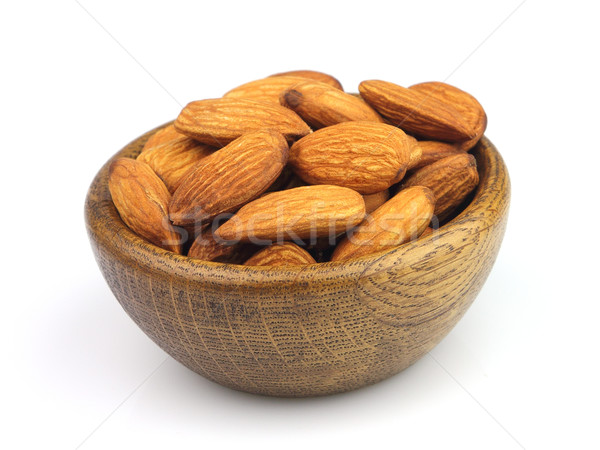 Almonds kernel in a wooden plate Stock photo © Dionisvera