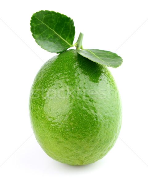 Fresh lime on a white background Stock photo © Dionisvera