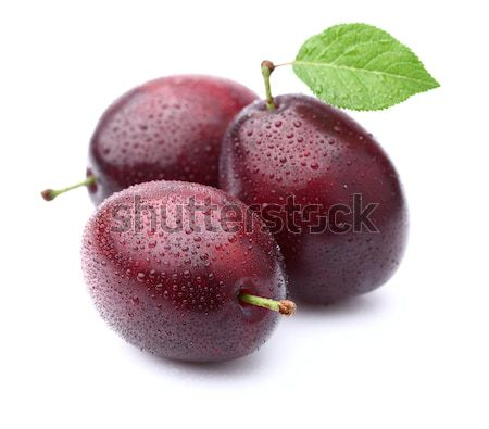 Sweet plums with leaves Stock photo © Dionisvera