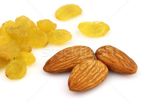 Raisins with almonds in closeup Stock photo © Dionisvera