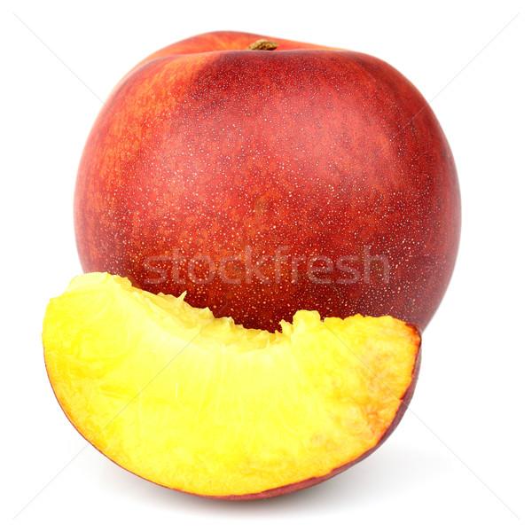 érett nektarin szelet étel gyümölcs fehér Stock fotó © Dionisvera