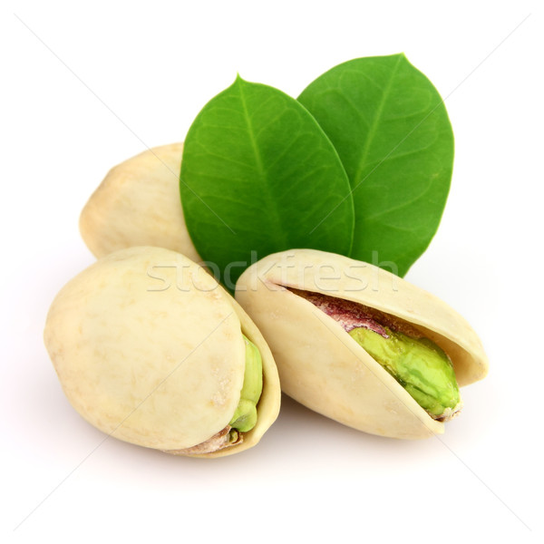 Séché pistache laisse alimentaire groupe usine Photo stock © Dionisvera