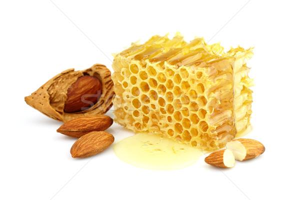 Honeycomd with almonds Stock photo © Dionisvera