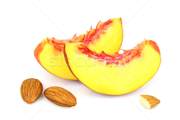 Almonds kernel with slices of peach Stock photo © Dionisvera