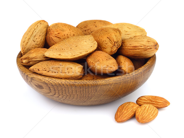 Almonds in a wooden plate Stock photo © Dionisvera