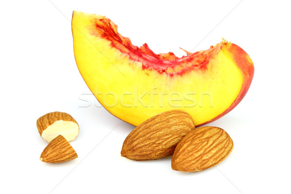 Almonds kernel with slices of nectarine Stock photo © Dionisvera